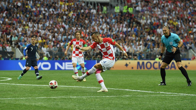 Ivan Perisic striking the ball for his goal against france in the world cup final