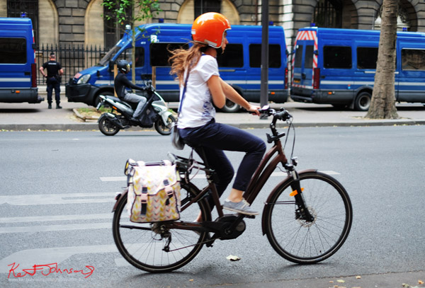Lady bike commuter in helmet. Nobody wears a helmet in Paris, and not one like this! If you're going to the Cité.. Shots from Paris on June 26 2017 for Street Fashion Sydney.