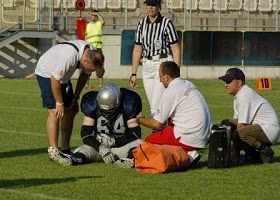 Showing consideration for a football player who is hurt.