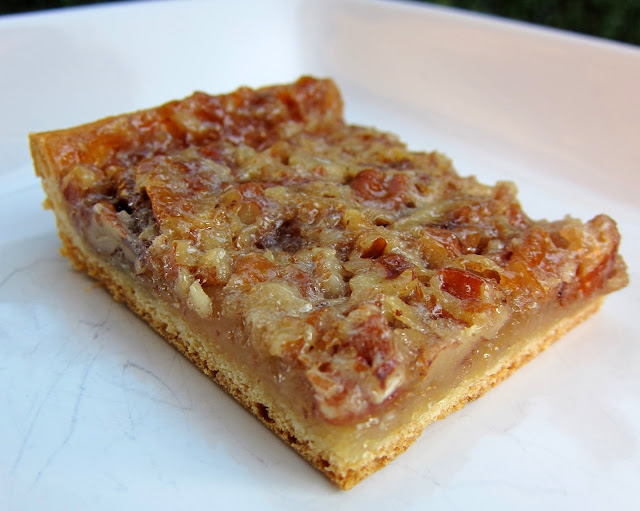 Easy Crescent Pecan Bars - crescent roll crust topped with a delicious pecan pie filling. SO easy and they taste amazing!!! There are never any left! Everyone always asks for the recipe!