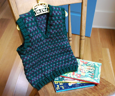 knitted vest in hunter green with sage green and deep purple checks