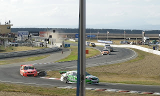 RACE CARS TAKING A BEND