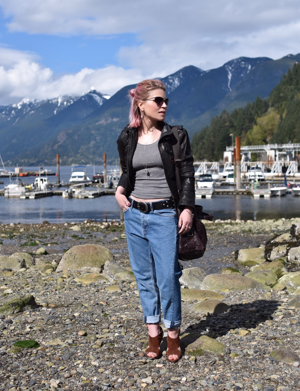 Monika Faulkner outfit inspiration - styling slouchy reworked jeans with a tank, moto jacket, and suede open-toe shoes