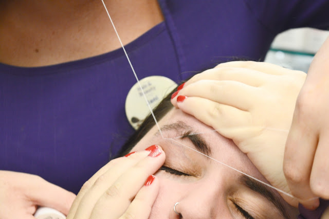 Blogger getting eyebrows threaded at Supercuts