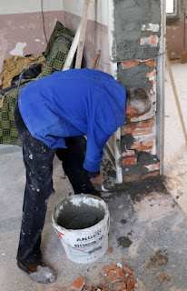Sally slapping concrete in place