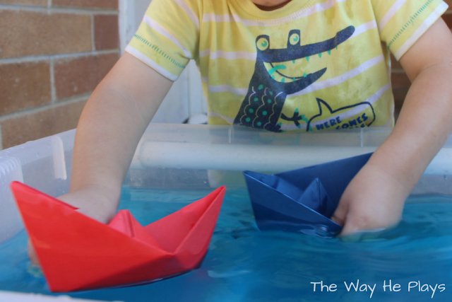 Playing with coloured paper boats