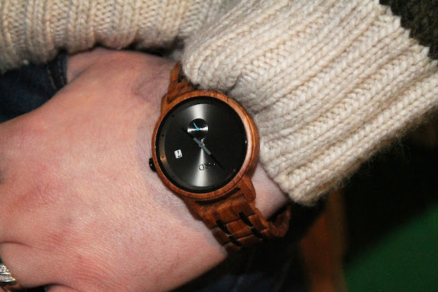 close up of wooden watch on mans wrist
