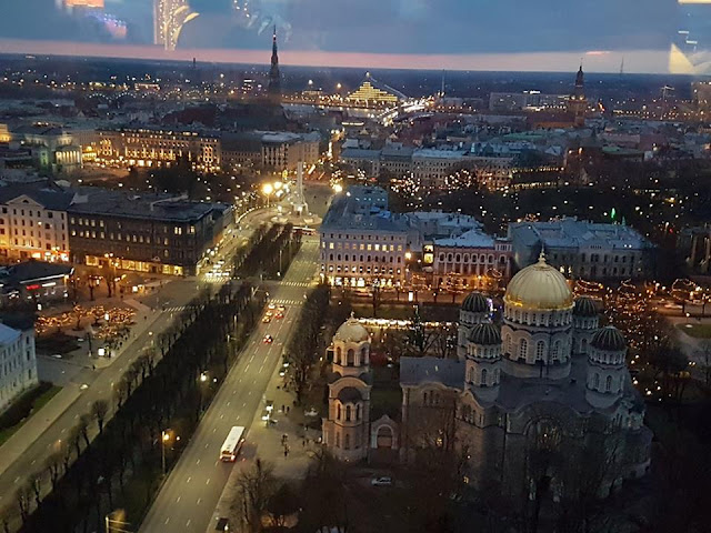 Skyline Bar Radisson Blu Latvia Hotel view Riga sun set night time