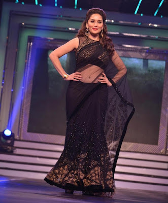 A Popular Indian Actress, Bollywood Diva and a Legend (Madhuri Dixit) Looking Gorgeous In Embellished Black Net Saree. Beside Acting Madhuri Dixit is also well-known dancer and TV host.