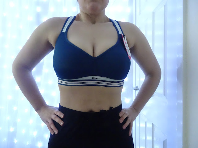 woman standing in blue sports bra