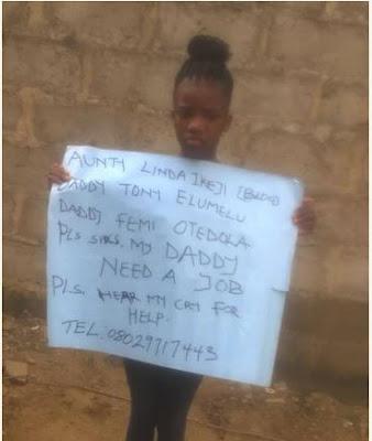 Little Girl Holds Placard Begs Otedola, Tony Elumelu, Linda Ikeji To Help Her Father (Photo)