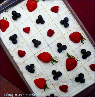 Frozen Red, White and Blueberry Bars, a refreshing frozen dessert perfect for Memorial Day, Independence Day or any hot summer night | Recipe developed by www.BakingInATornado.com | #recipe #dessert #berries