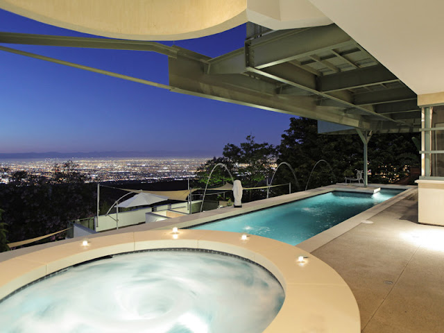 Photo of large terrace with hot tub and long pool