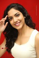 Actress Ritu Varma Stills in White Floral Short Dress at Kesava Movie Success Meet .COM 0217.JPG