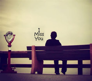 sad boy sitting on the bench with i miss you pic