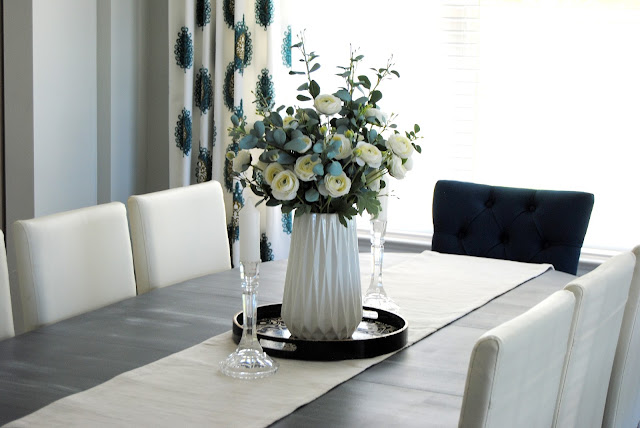 dining room, mix and match dining chairs, white decor, teal decor, aloof gray, curtain panels, drapes, curtains, faux floral, faux flowers, DIY, vintage rug, utah, table setting, tablescape, blue design, blue decor, teal, white, utah blogger, utah, blogger, chalk paint, painted dining table, painted furniture, how to hang curtains, how to style a dining room, best gray paint, favorite paint color, simple decorating, simple design, 8 chairs, 6 chairs, table that seats 8, captain chairs, dining room lighting, progress lighting, debut chandelier, six light chandelier, 6 light chandelier, black chandelier, exposed light bulbs, floating shelf, floating shelf dining room, minted art, water color art, water color painting, sunburst mirror, table runner, gray rug, safavieh rug, affordable design, design on a dime, laminate wood floors, flooring, cheap flooring, cheap hardwood, hardwood, laminate hardwood, wood stair treads, white risers, stairs, wood stairs, laminate stairs, colorful design