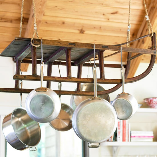this creative hanging pot holder is made from an old wooden sled