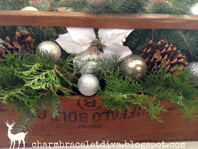 Vintage wooden toolbox rustic Christmas centerpieces poinsettias greens pine cones ornaments
