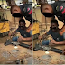 Nigerian Policeman Spotted Repairing His Gun at a Welder's Workshop