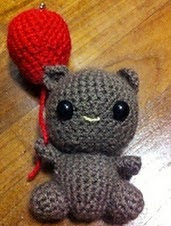 http://www.ravelry.com/patterns/library/teddy-with-balloon