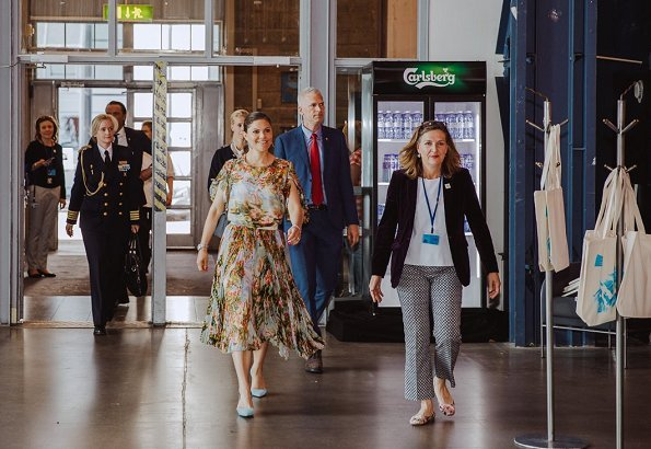 Crown Princess wore Frida dress by Swedish designer Jennifer Blom, and she wore By Malene Birger Pumps and carried Valentino shoulder bag