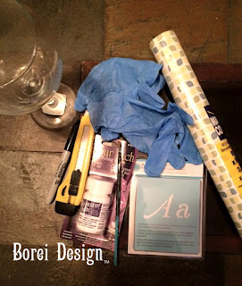 DIY tutorial on how to create etched monogram wine glasses.