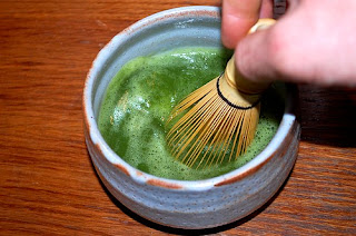 Whisking matcha tea
