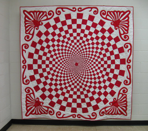Red and White Vortex Quilt Free Pattern designed by Paula of Quiltrascal, The original was made around 1910.