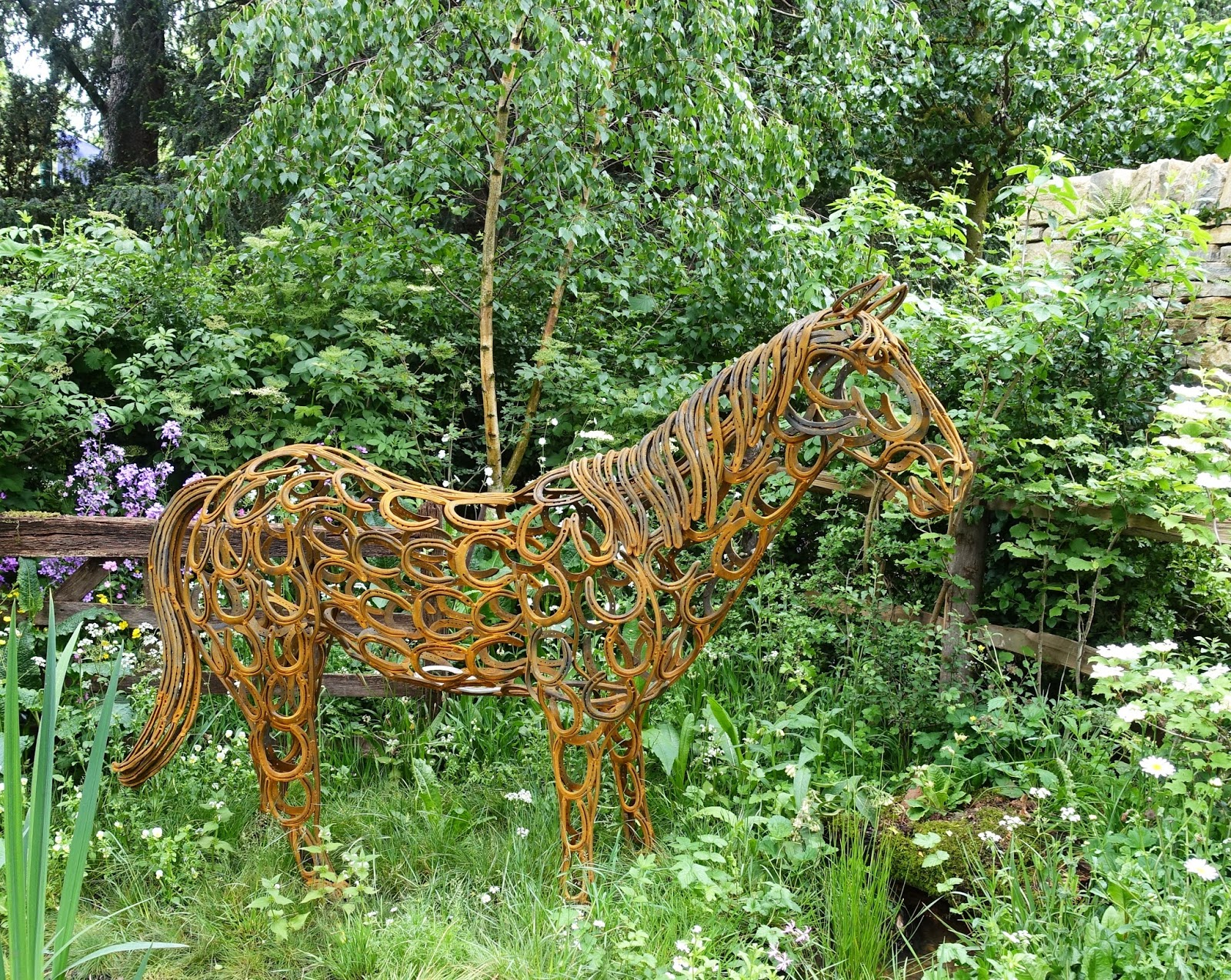 A horse made of horseshoes from an artisan garden, Chelsea Flower Show 2017