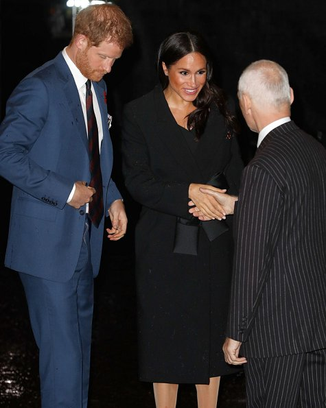 Kate Middleton wore Roland Mouret asymmetric neck dress. Meghan Markle wore Stella McCartney tie detail coat