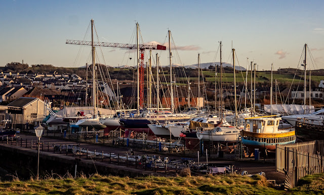 Photo looking across the hard-standing at Maryport Marina from the sea wall