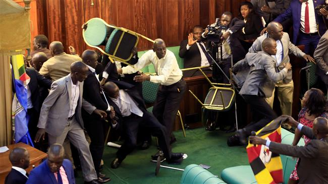 Ugandan lawmakers fight over presidential age limit bill