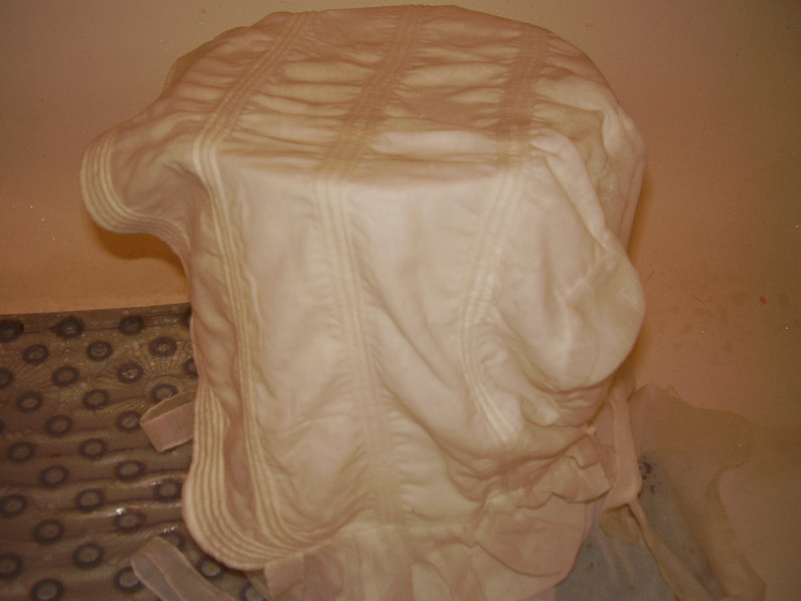 Starched sheer corded sunbonnet drying.