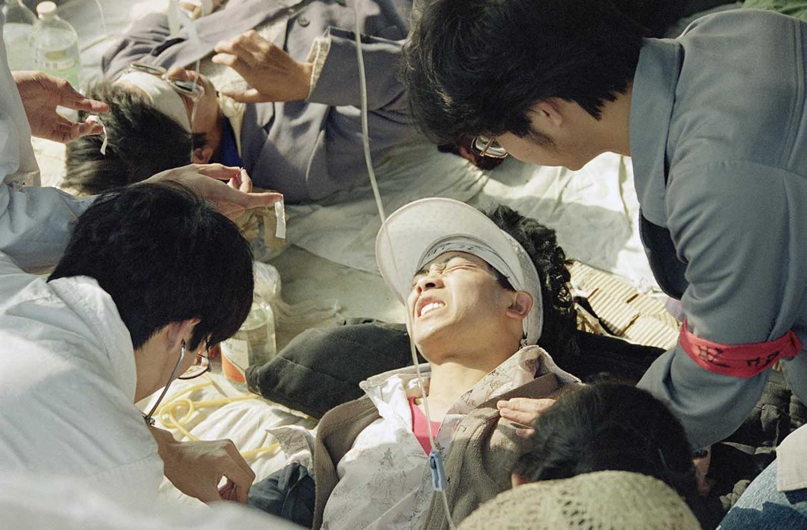 A striking Beijing University student is given first aid by medics at a field hospital in Tiananmen Square, on May 17, 1989, the fourth day of their hunger strike for democracy.