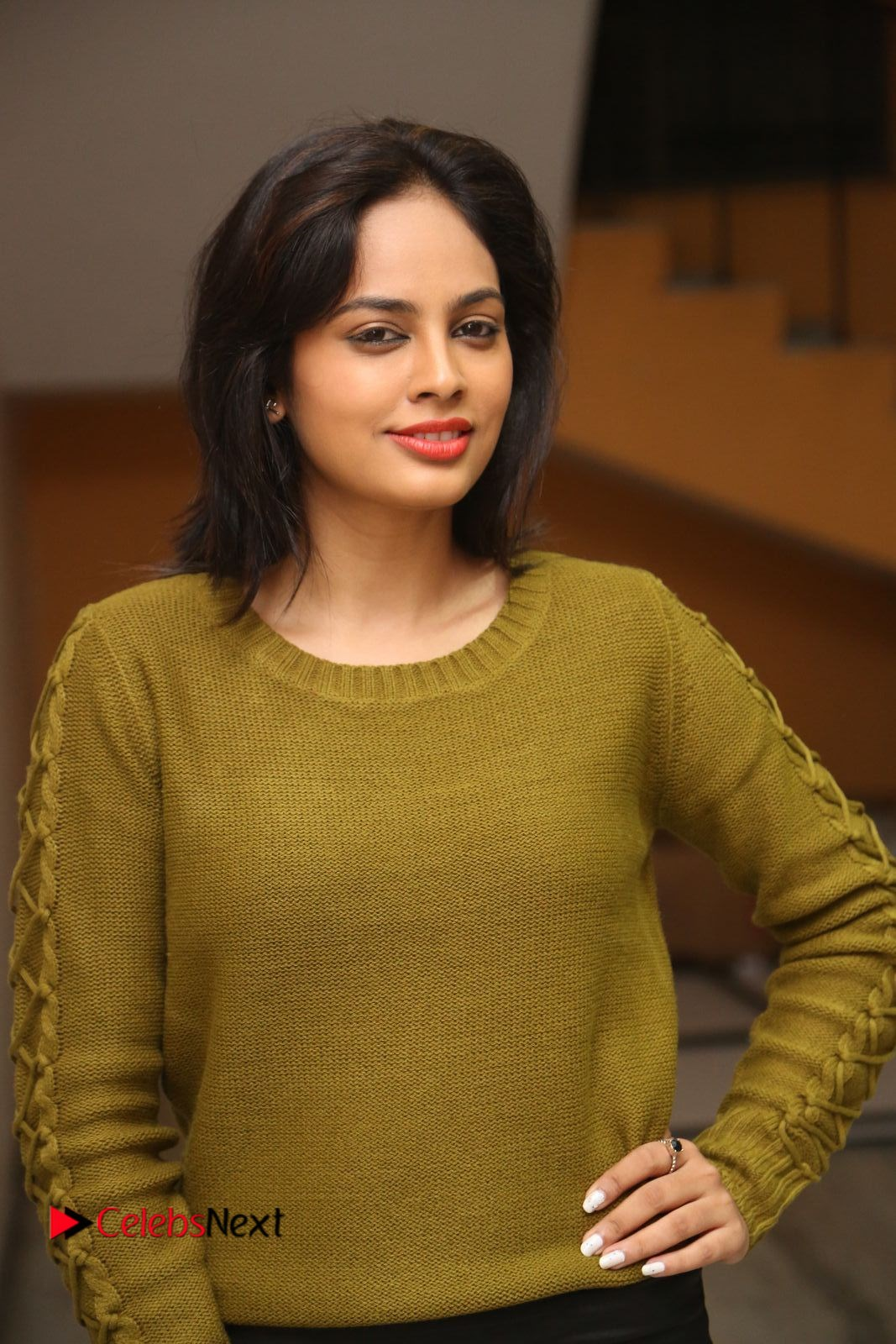 Nandita Swetha Stills in Leather Pants at Janaki Ramudu Audio Launch