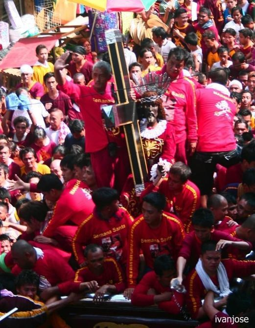 The Black Nazarene along a narrow street in Quiapo during Holy Week