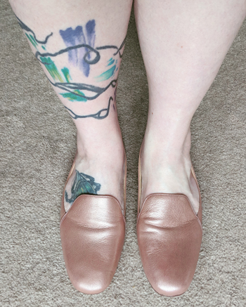image of my legs below the knee; on my feet are rose gold loafers