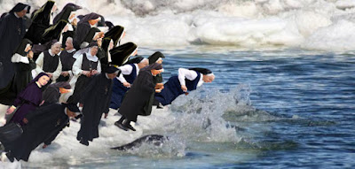 Nuns diving into the ocean picture