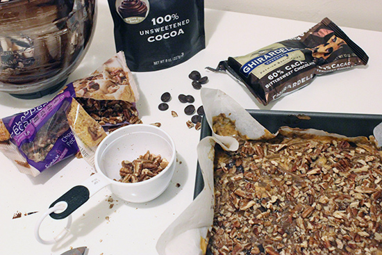 Topping Chocolate Pumpkin Brownies with Chopped Pecans