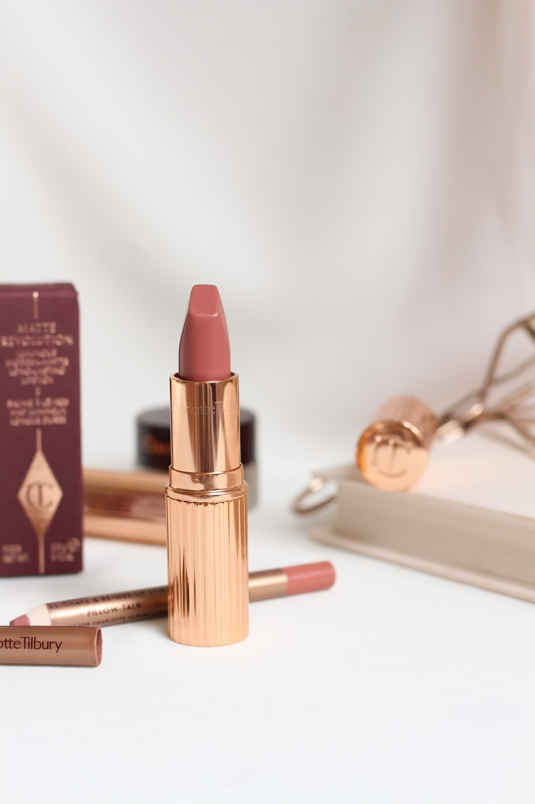 charlotte tilbury pillowtalk lipstick and lip liner with white backdrop