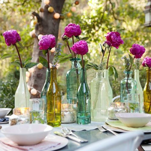 beautiful garden party decor with recycled bottles and flowers