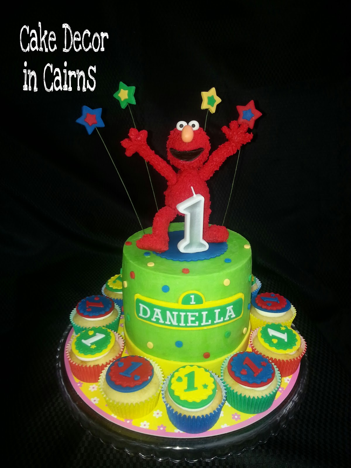 Elmo Fondant topper on Green coloured ganache recipe cake. colored