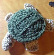 http://www.ravelry.com/patterns/library/tiny-turtle-tape-measure