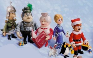 Main characters sitting in the snow in Santa Claus is Comin' to Town 1970 animatedfilmreviews.blogspot.com