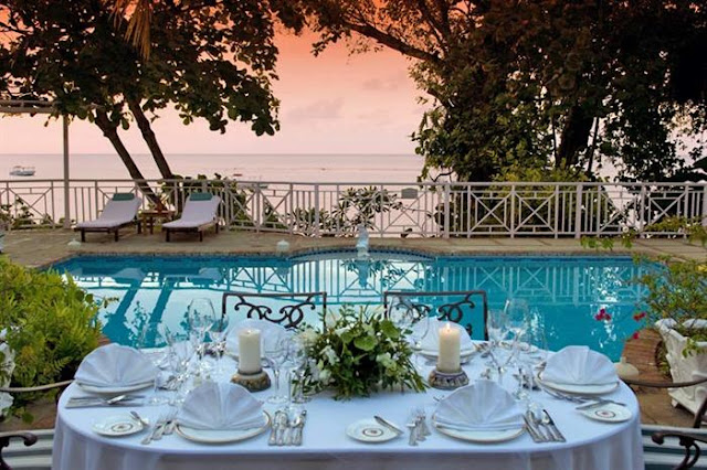 Photo of outdoor dinning table by the pool with amazing view