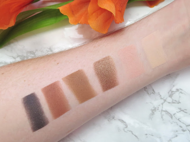 a picture of Too Faced Sweet Peach Palette (swatch, swatches) :Peaches 'n Cream (matte milky peach), Georgia (matte peachy pink), Caramelized (dark gilded bronze), Puree (metallic dark bronze), Summer Yum (matte gingerbread), Talk Derby To Me (shimmering black violet)