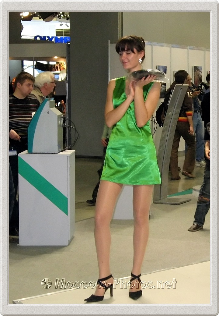 Promo model in green dress at Photoforum - 2008
