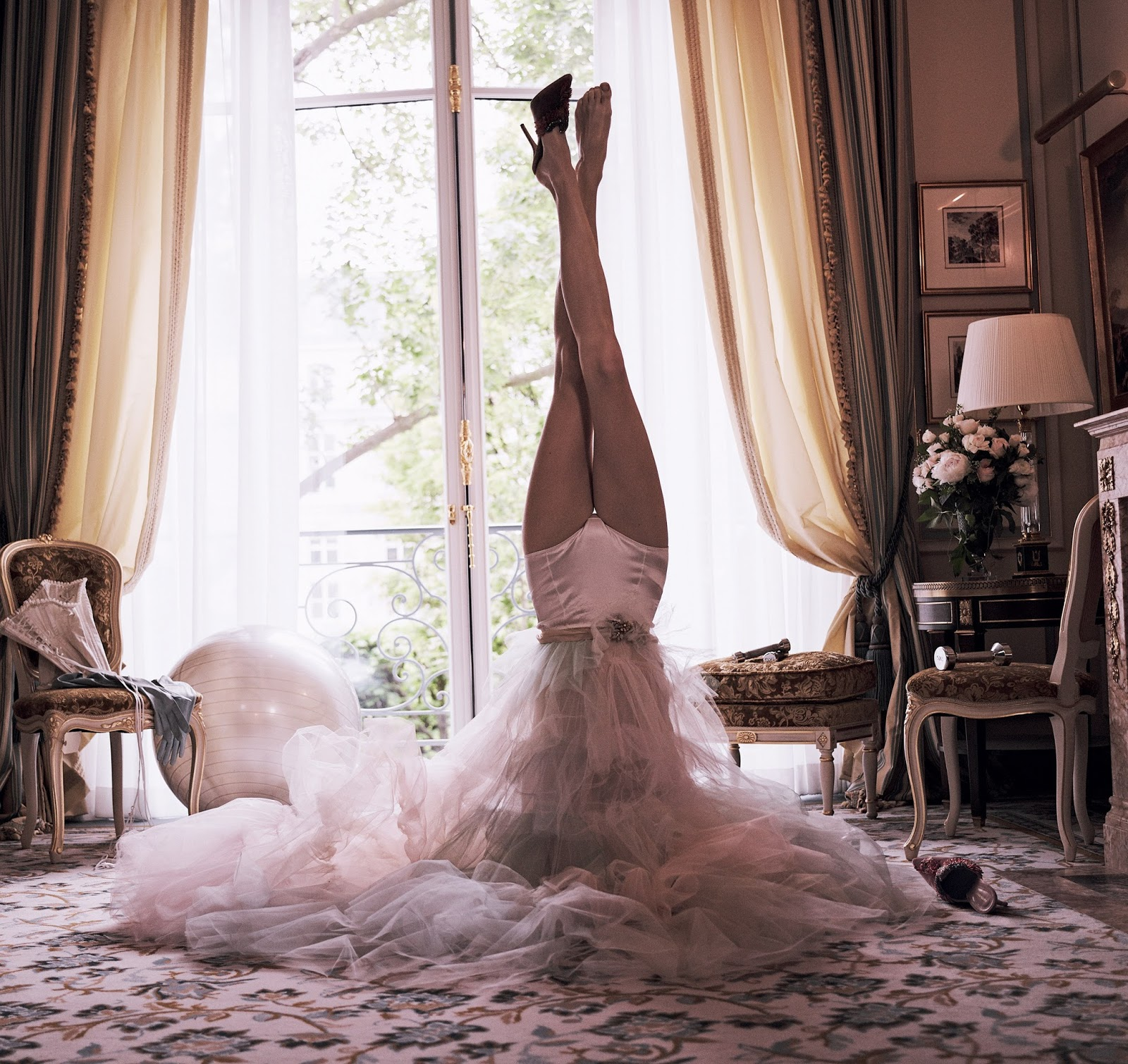 Woman standing on head in suite of Ritz Paris by Vogue