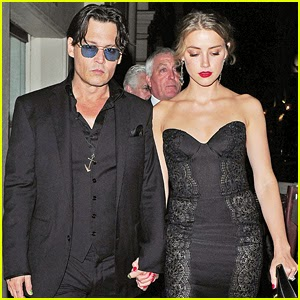 Johnny Depp , Amber Heard Hold Hands After the GQ Men of the Year Awards 2014