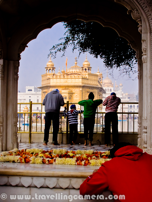 Year 2012 for us started with a new Journey towards Amritsar from Phagwara. We left early morning towards Golden Temple in Amritsar, Punjab. Check out this quick Photo Journey from Harmadir Sahib/Golden Temple/Swarna madir ...Here is very first view of Golden Temple, as we enter through the main gate of this campus. Golden Temple in Amritsar is also known as Harmadir Sahib and Swarna Madir.After entering into the campus of Golden Temple, we tempted to go near the lake which was surrounding actual Temple made up of Gold. Even the fish inside the lake was also Golden :)A boys havingholy bath in lake which surrounds Golden Temple.Dukh Bhanjani Beri & Ath Sath Tirath...All sides of Sarovar were full of people busy in their prayers for new year.There are some regulations to get into the lake for holy bath and iron chains are there on the lake-side which help people in going inside the lake and be safe while having the holy bath.The Golden Temple is surrounded by a large lake which is also known as Sarovar. Sarovar consists of Amrit ('holy water' or 'immortal nectar'). There are four entrances to Golden Temple, signifying the importance of acceptance and openness. Inside the temple complex there are many shrines to past Sikh gurus, saints and martyrs. There are three holy trees (bers), each signifying a historical event or Sikh saint. Inside the temple there are many memorial plaques that commemorate past Sikh historical events, saints, martyrs and includes commemorative inscriptions of all the Sikh soldiers who died fighting in World Wars I and II. (Courtsey - http://en.wikipedia.org/wiki/Harmandir_Sahib)1January 2012 was a foggy day, as you can see in post of these photographs. These are not as sharp as these should be... Anyway, weather was not that important for people who wanted to come to Golden Temple... Weather conditions in Amritsar is usually extreme in summers as well as winters. This is probably one of the top cities in north India, which is hottest in summers and chilling in wintersSikh temples (Gurdwaras) like Harmandir Sahib are open to all persons regardless of their religion, colour, creed, or sex. The only restrictions on the Harmandir Sahib's visitors concern their behavior when entering and while visitin    Maintaining the purity of the sacred space - Upon entering the premises, removing one's shoes (leaving them off for the duration of one's visit) and washing one's feet in the small pool of water provided.Not drinking alcohol, eating meat, or smoking cigarettes or other drugs while in the shri    Dressing appropriately: Wearing a head covering (the temple provides head scarves for visitors who have not brought a suitable covering)... even there are lot of shops outside the Golden Temple where appropriate head-covers are available at reasonable cost.   The Entrance to the Harmandir Sahib as seen from outside of the complex..Not wearing shoes... There is a particular place to collect your shoes and get back on return from Golden Temple. Services are free and convenient. A token is given to everyone for tracking purpose One must also sit on the ground while in the Darbar Sahib as a sign of inferiority to both the Guru Granth Sahib and God...Here is an entrance for Langar in Golden Temple.Langar is the term used in the Sikh religion or in Punjab in general for common kitchen/canteen where food is served in a Gurdwara to all the visitors(without distinction of background) for free. There was huge rush on 1st Jan' 2012, so we thought of skipping it. Otherwise, it's a wonderful experience to have langar at a Gurudwara. At the langar, only vegetarian food is served, to ensure that all people, regardless of their dietary restrictions, can eat as equals. Langar is open to Sikhs and non-Sikhs alike.Many folks sit on Sarovar-side for peaceful prayers at Golden Temple, Amritsar. And it's a must thing to sit inside the Golden Temple once There are various other Gurudwaras inside the campus. (Nishaan Sahib)The Harmandir Sahib which is also referred to as the Golden Temple, is a prominent Sikh gurdwara located in the city of Amritsar, Punjab, India. Construction of the gurdwara was begun by Guru Ram Das, the fourth Sikh Guru, and completed by his successor, Guru Arjan Dev.During the eighteenth century, the Harmandir Sahib was the site of frequent fighting between the Sikhs on one side and either Mughal or Afghan forces on the other side and the gurdwara occasionally suffered damage. In the early nineteenth century, Maharaja Ranjit Singh secured the Punjab region from outside attack and covered the upper floors of the gurdwara with gold, which gives it its distinctive appearance and English name of 'Golden Temple'.There was huge line for main Temple inside the Sarovar. In fact, there were multiple rows... The good part was the discipline. Most of the folks were very disciplined and there were some सेवार्थीs,  who were continuously cleaning the floor where this folks were aligned to enter into Golden Temple. Whole campus is usually clean and noone litters inside the Golden Temple. I wish that all Indians do the same thing outside these temples as well. In fact, just outside Golden Temple, whole market is extremely polluted.Some of the folks were telling some stories through songs and musical instruments. Various folks were calmly listening to these four Sardars with Blue Pagadi.Sikhism is a monotheistic religion founded during the 15th century in the Punjab region, by Guru Nanak Dev and continued to progress with ten successive Sikh gurus (the last teaching being the holy scripture Gurū Granth Sāhib Ji). It is the fifth-largest organized religion in the world, with over 25 million Sikhs and one of the most steadily growing. This system of religious philosophy and expression has been traditionally known as the Gurmat (literally 'of the gurus'). Punjab of India is the only region in the world with a majority Sikh population. (courtesy - http://en.wikipedia.org/wiki/Sikhism)There are some corridors on all sides of Golden Temple, where people sit and continue their prayers. Many folks come here with families with a proper day plan or two, when they provide their services at Golden Temple campus and have some rest in these regions of the Swaran Mandir.A view of Golden Temple surrounded by Sarovar and lots of people form various parts of the nation.Detailed information about Golden Temple is available at http://en.wikipedia.org/wiki/Harmandir_Sahib